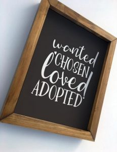"""frame that has the text """"Wanted Chosen Loved Adopted"""" written in white"""