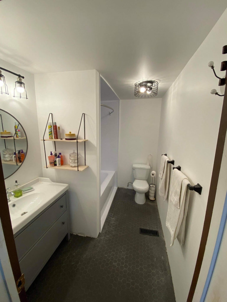 Broad view of the bathroom before the shower curtains went up